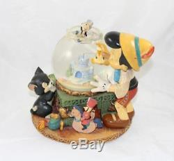 Snowglobe musical Pinocchio DISNEY Toyland bocal poisson Cleo Figaro et Jiminy